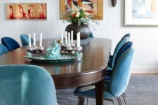 04 blue and turquoise upholstered chairs create a mood in this dining room