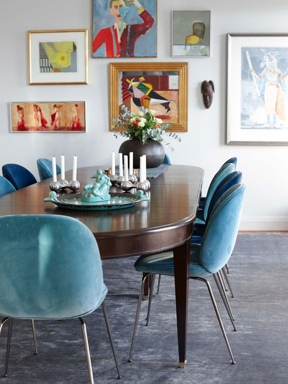 blue and turquoise upholstered chairs create a mood in this dining room
