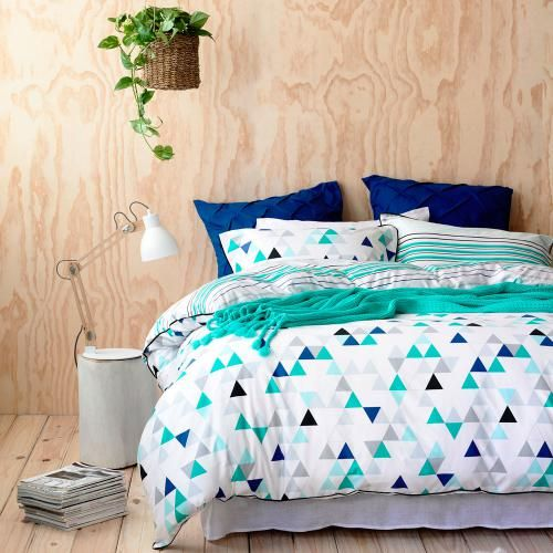 bold turquoise, blue, white and black bedding for a fresh touch in your bedroom