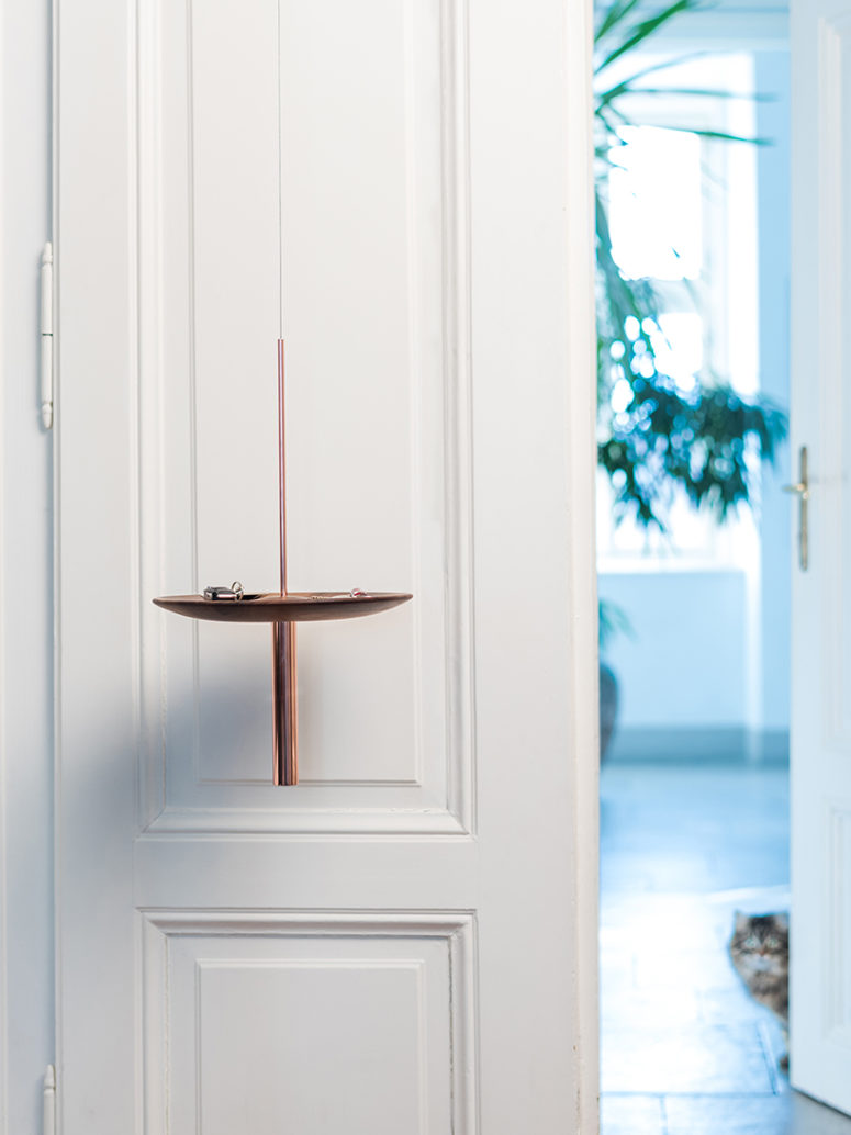 Hang it at the entrace to use as a catch all tray, it has great aesthtic appeal