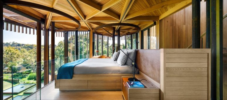 The bedroom is designed as if it's a real tree house, it's located right under the roof and has magnificent views