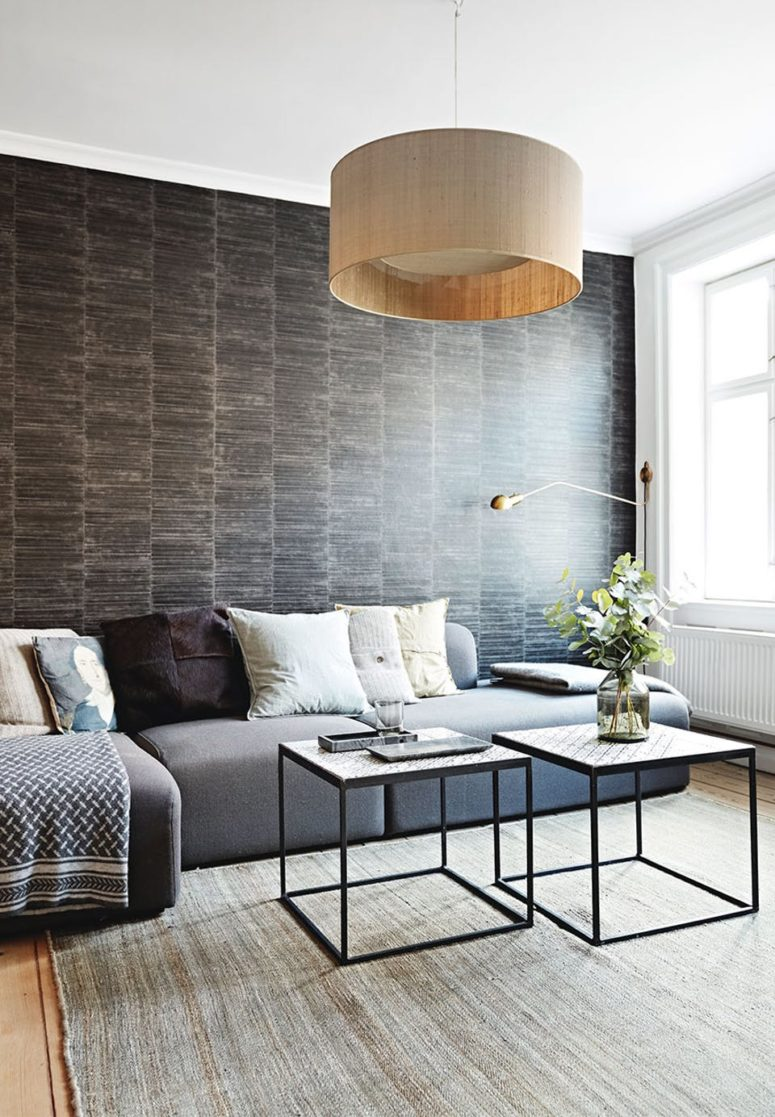 The living room is another space with an eye-catchy wallpaper wall, and this one imitates chocolate wood planks