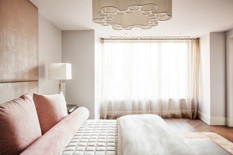 The master bedroom is done in pink and with rose gold touches