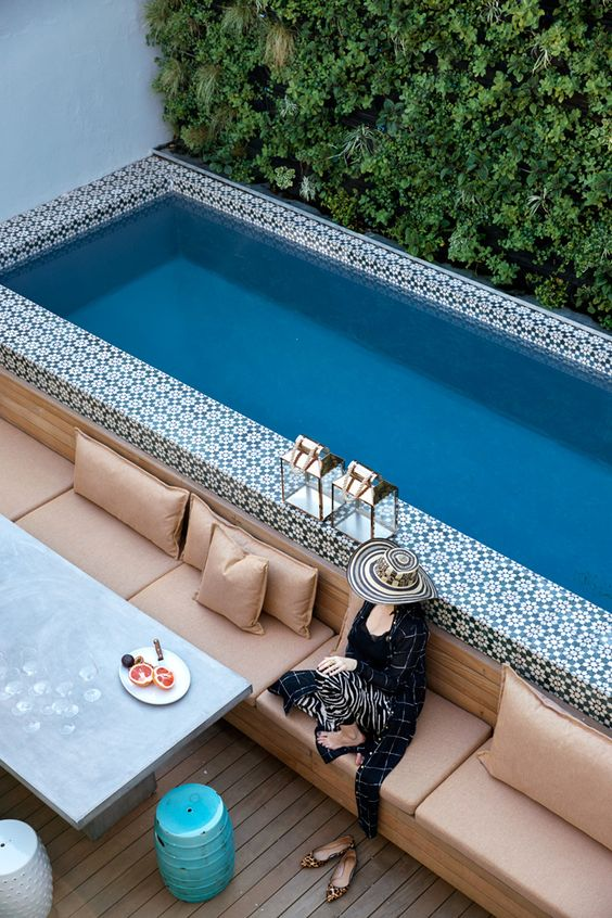 a bold Moroccan tile clad pool in a small courtyard