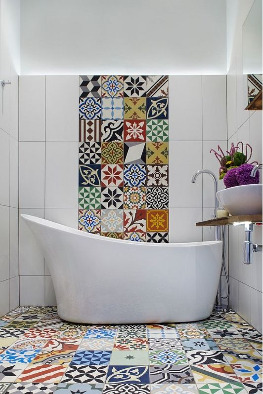 colorful mosaic tiles on the floor and a bold stripe on the wall