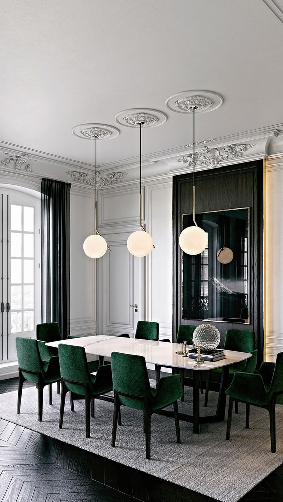 emerald upholstered chairs on black framing look chic and add color to the area