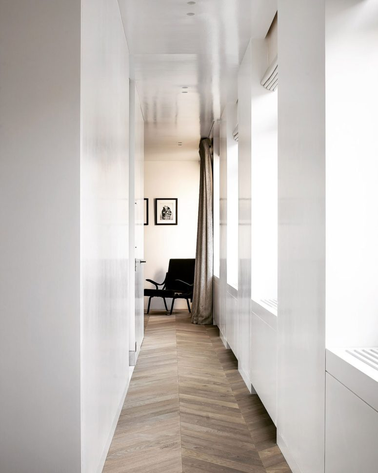 Lots of white and large windows provide the spaces with natural light