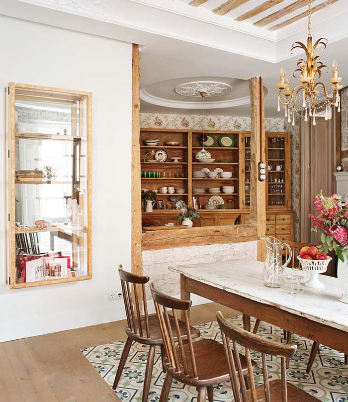 The cupboards are rustic and vintage ones, they display different dishes and cups in a cool way