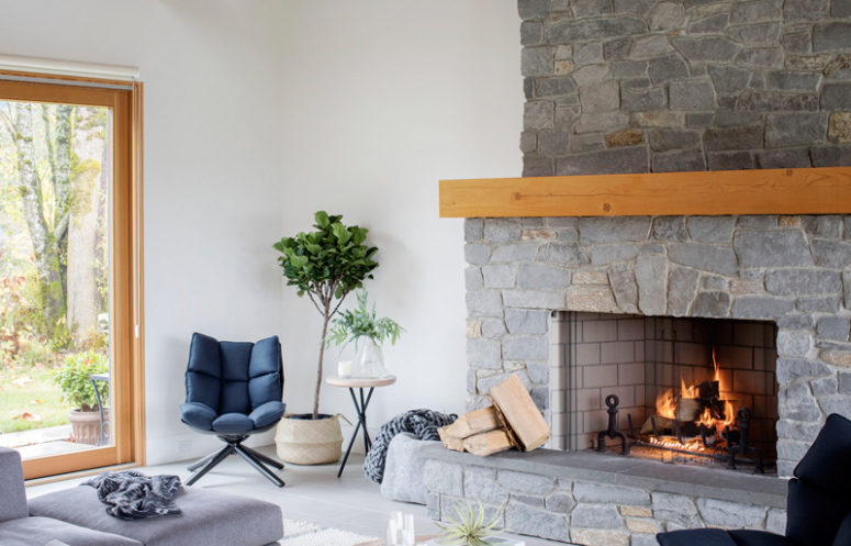 The gorgeous stone clad fireplace is working, and it not only adds coziness but also reminds as that this is a rustic space