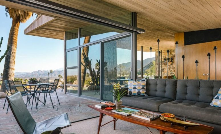This is an outdoor-indoor lounge that can be opened to the outside with glass doors at any moment