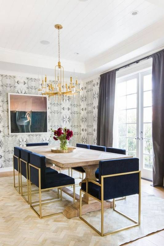art deco navy and gold upholstered chairs create a cool glam ambience
