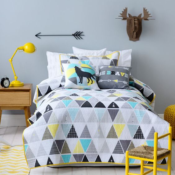 grey, turquoise, black and yellow pillows and a duvet for a modern feel