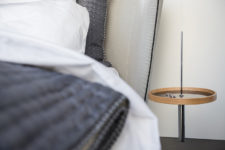 07 The design used as a bed-side table in glossy black marble