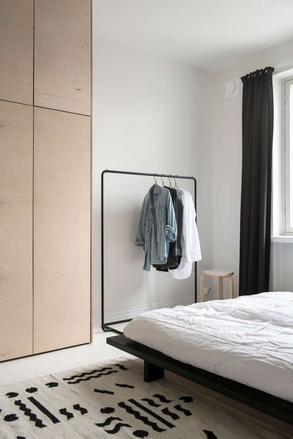 There's a large wooden wardrobe and an additionalclothes rack for the most used pieces