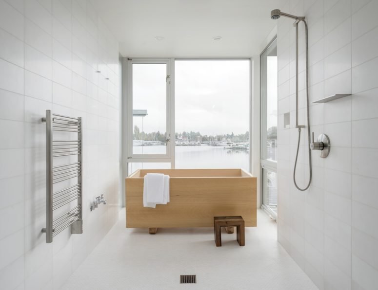 There's a master bathroom with gorgeous views and a wooden soak tub in Japanese style