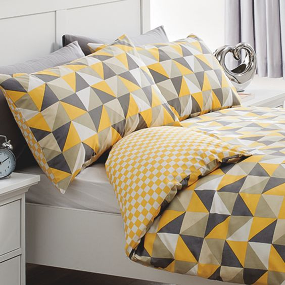 grey, black, yellow, white and black triangle bedding for a sunny feel in your bedroom