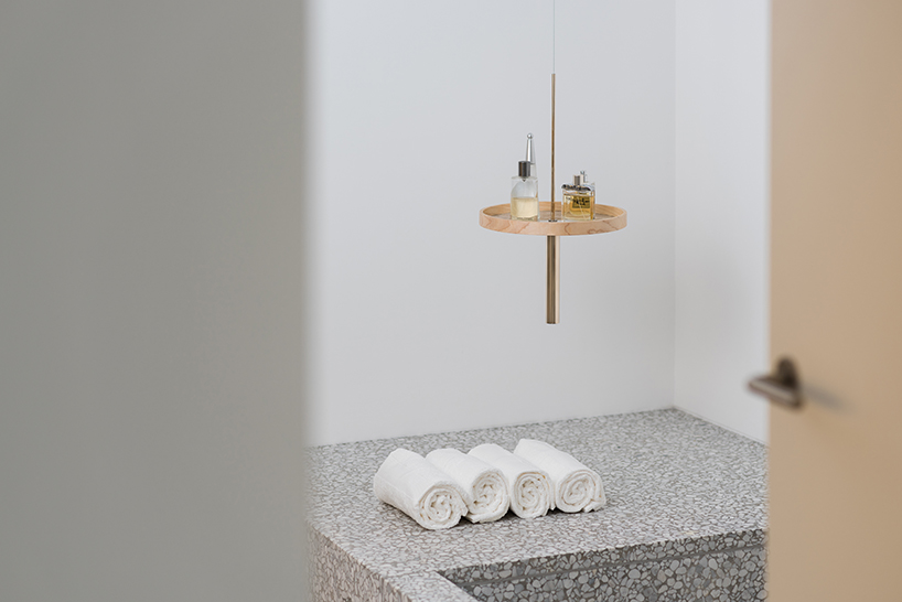 The circulum ceiling shelf used in the bathroom in white marble