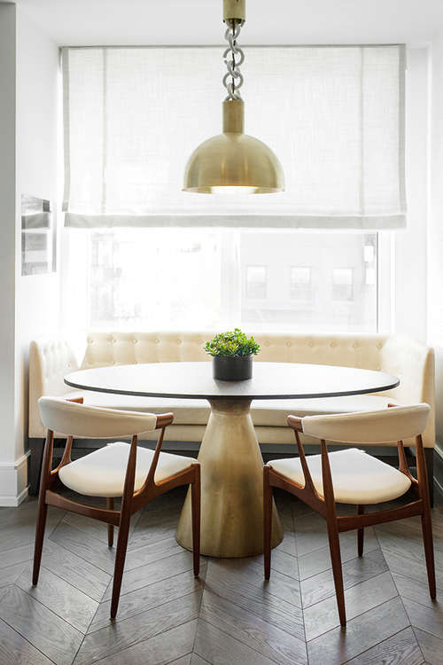 The dining space is mid-century modern, with brass details for a chic look
