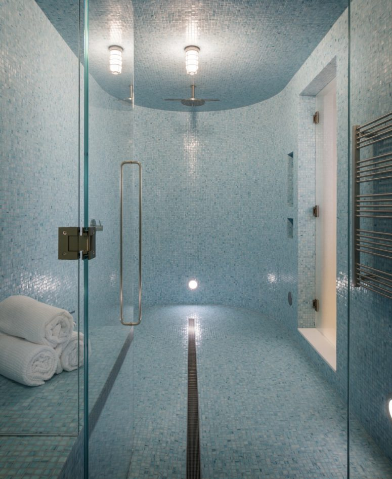 There's a home spa clad with small blue tiles, so gorgeous