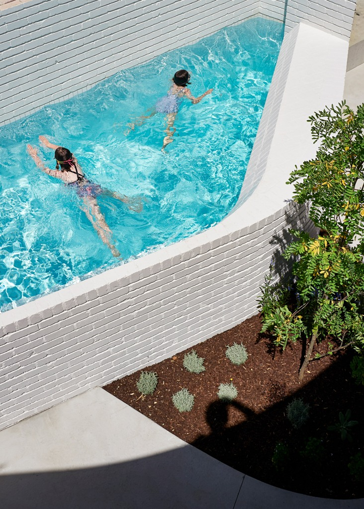The pool is also clad with brick to fit the home decor style