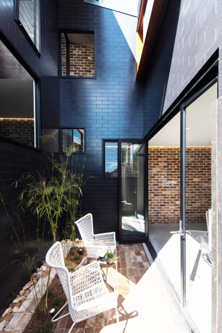 There's a small courtyard with greenery and chairs, it refreshes the kitchen