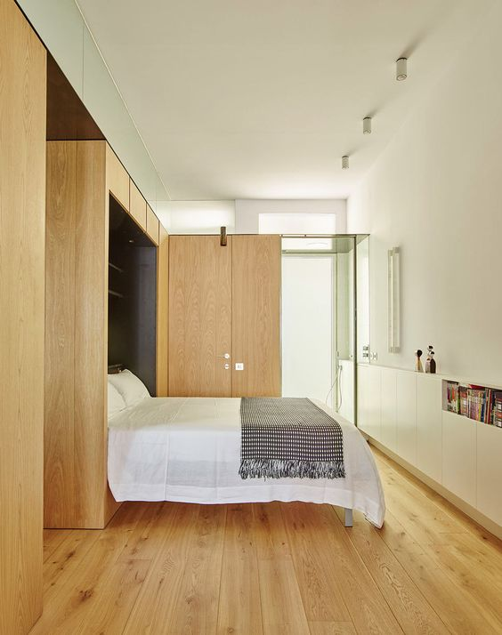 There's another bedroom with a folding bed, almost fully clad with oak wood for comfort