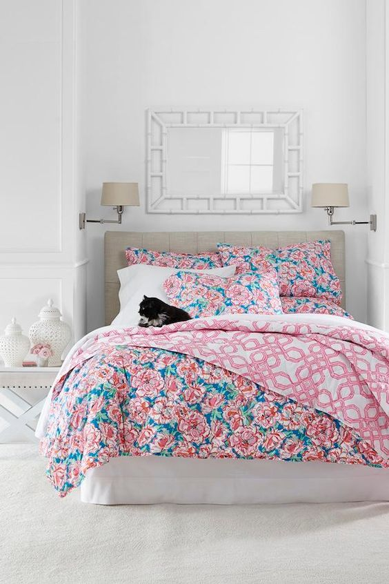 blue and pink floral bedding with geometric patterns on the lining