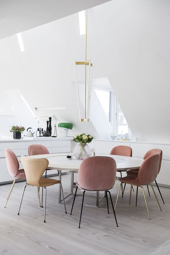 powder pink and beige chairs are ideal to hint that this space is feminine