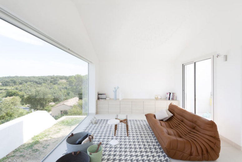 The brown leather sofa is placed to catch the valley views below and enjoy them