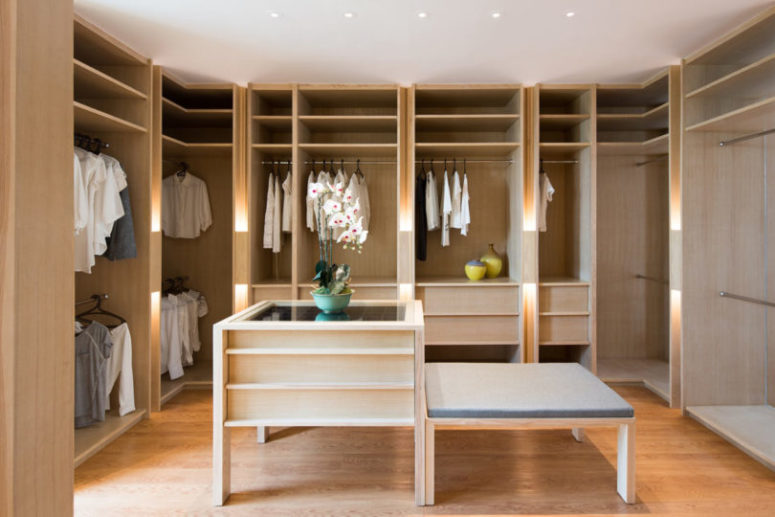 The closet is pure elegance with light-colored wooden wardrobes and an accessory chest, nothing unnecessary here