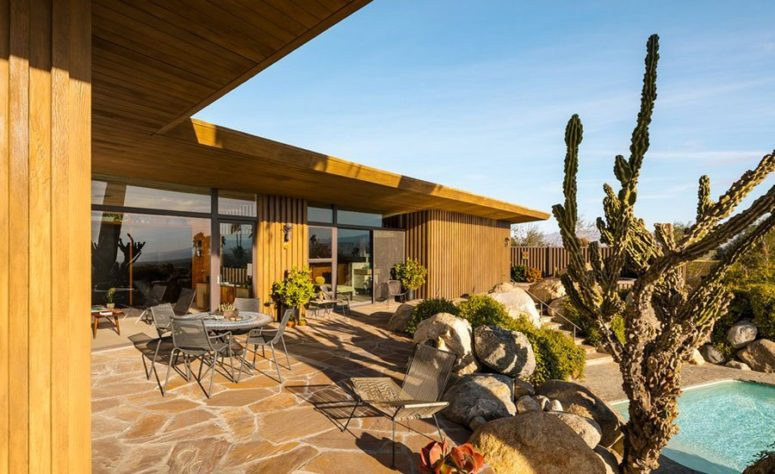 This is an outdoor dining zone with amazing landscaping and hardscaping