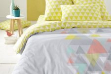 10 a grey duvet with some muted colored triangles and lime triangle print pillowcases