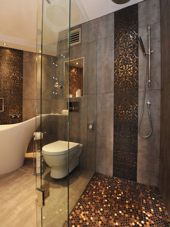 sparkling copper hexagon tiles accentuate the shower and niches