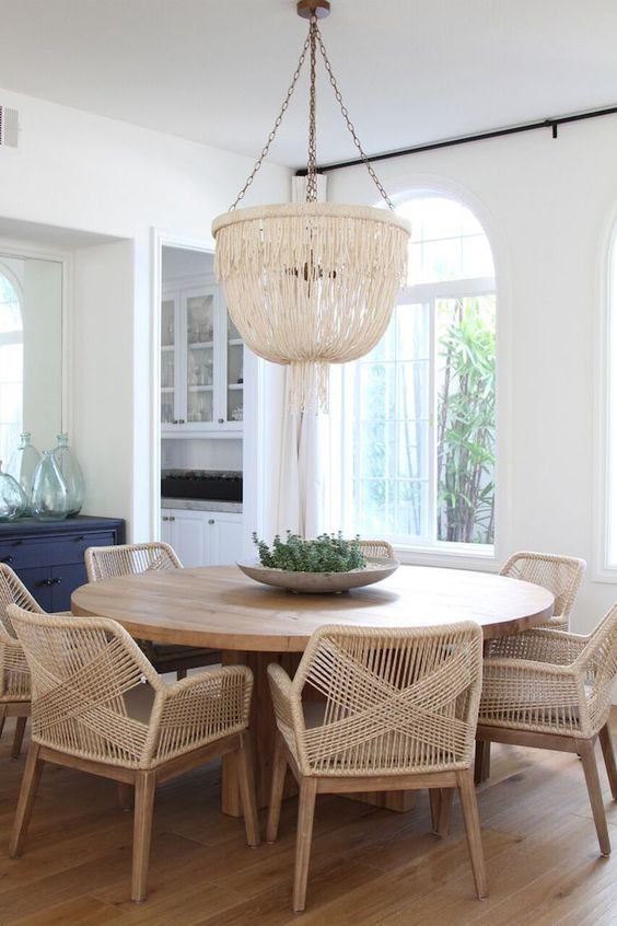 wicker chairs will make the dining space cozier and more inviting
