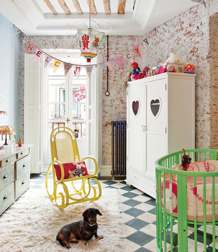 The kids room has also original stone walls, beams and fun and colorful furniture