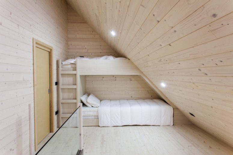 There's an attic sleeping area to fit under the roof, it's difficult to imagine a space cozier than that