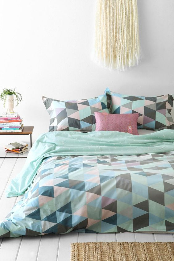 mint, green, blush, black triangle print bedding is ideal for spring and summer