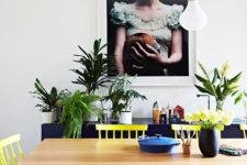11 sunny yellow chairs contrast with navy pieces and create a cool mood