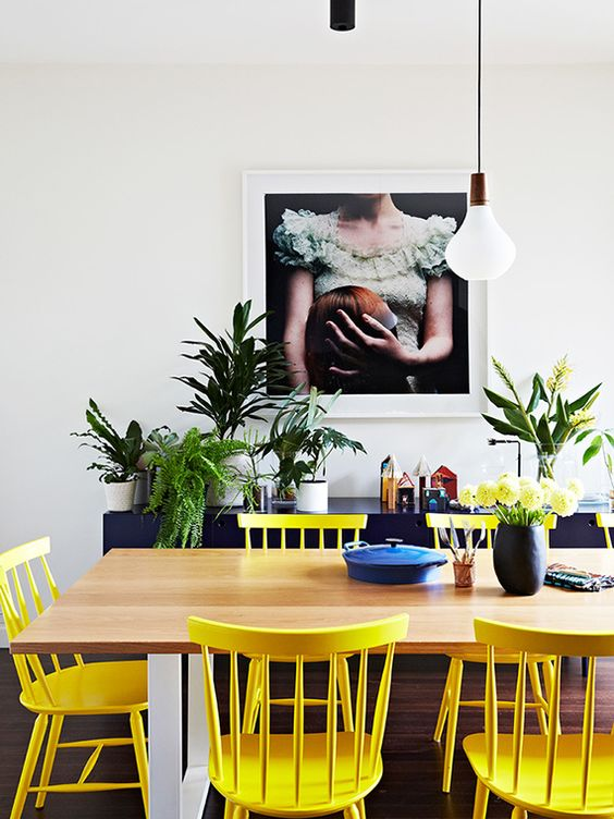 sunny yellow chairs contrast with navy pieces and create a cool mood