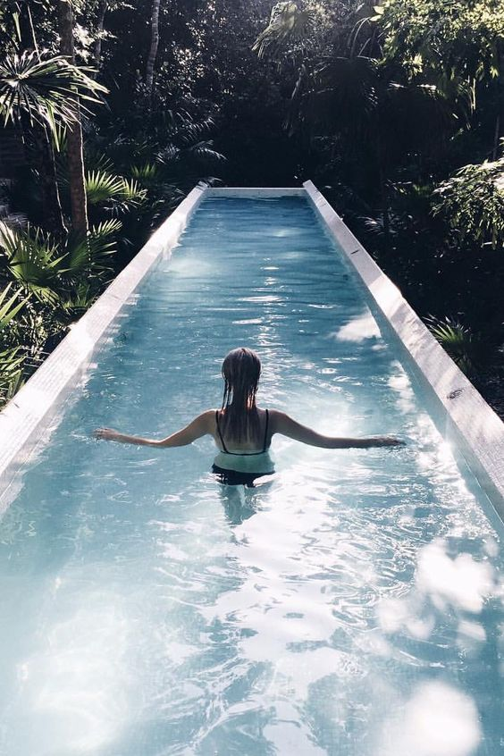 A Gorgeous White Clad Narrow Pool In A Tropical Garden