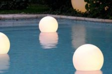 12 floating, waterproof LED globes for lighting up the pool, and you can swim with them