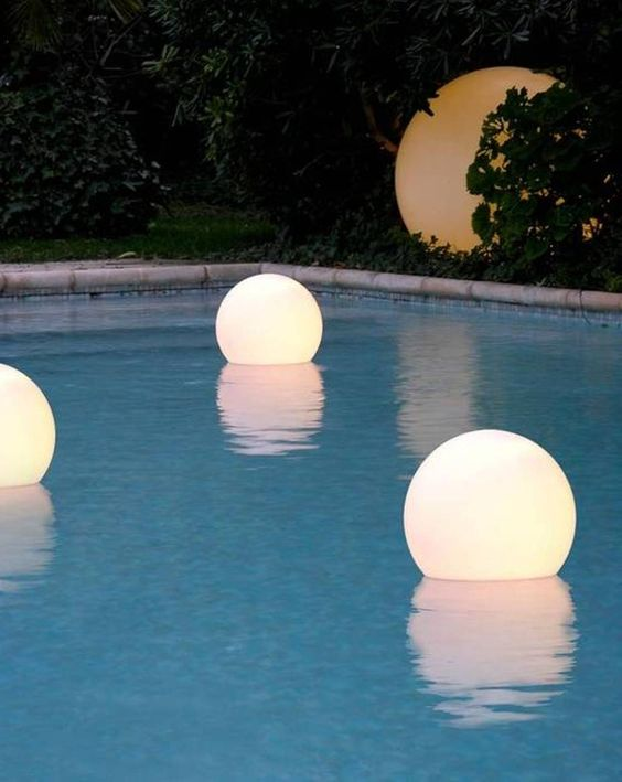 floating, waterproof LED globes for lighting up the pool, and you can swim with them