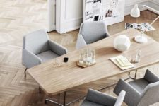 12 modern sculptural grey upholstered chairs make the space look laconic