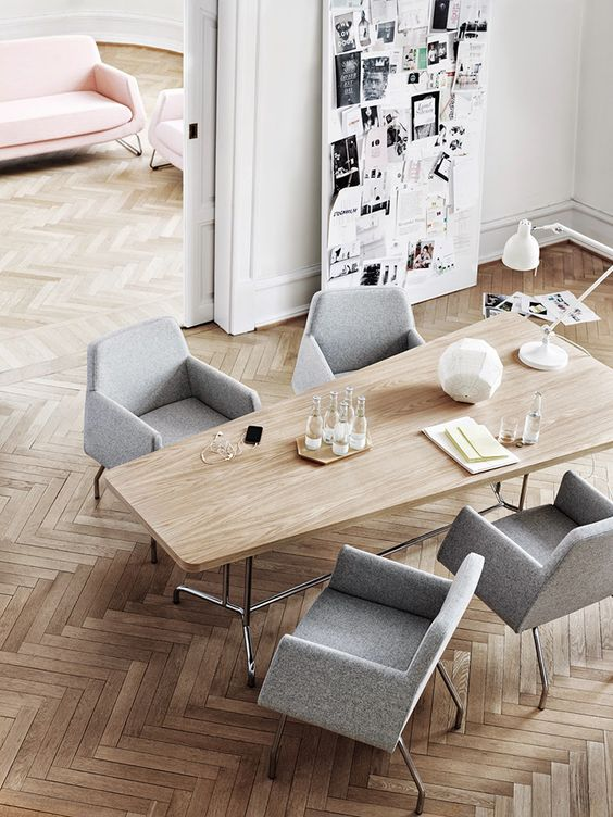 modern sculptural grey upholstered chairs make the space look laconic