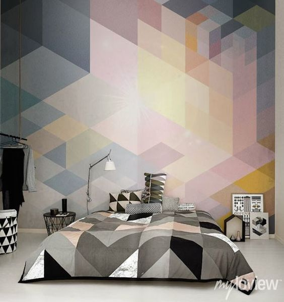 white, grey, black and blush triangle bedding and a matching geo wall mural