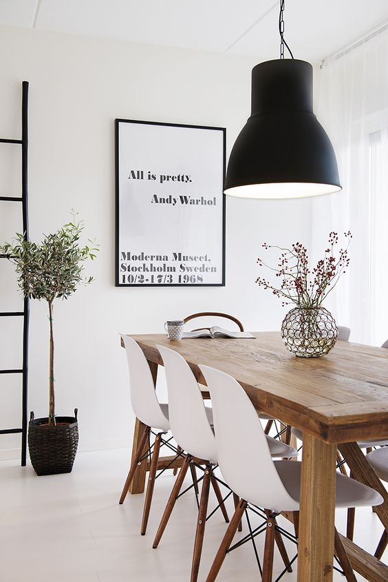 oversized black lamp makes a statement in this Scandinavian space