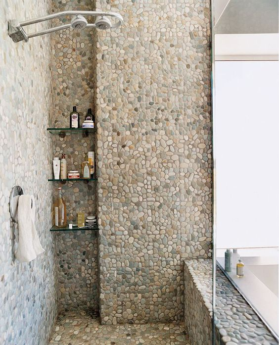 tiles imitating river pebbles will give your bathoom a soothing natural feel