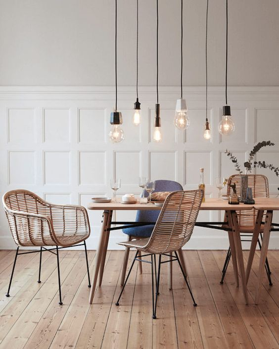 a combo of industrial bulbs over the dining space catches an eye