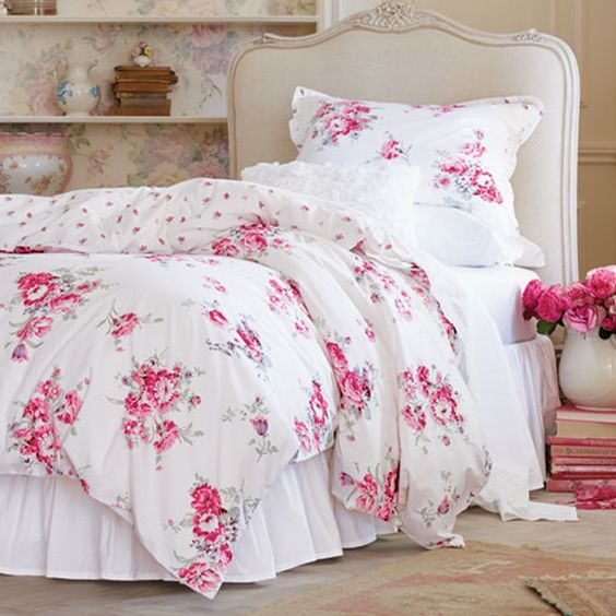 classic white bedding with pink flowers and white ruffled pillowcases