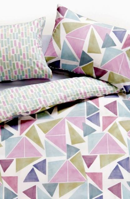 watercolor colorful chaotic triangle bedding for a more creative look